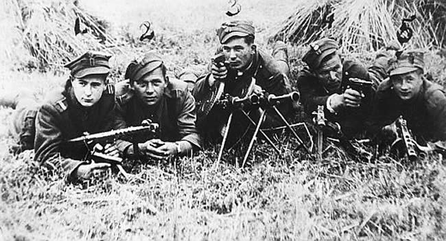 "Summer 1945: Soldiers from the 5th Wilno Home Army Brigade squadrons commanded by Lt. ""Zygmunt"" in the Bialystok area.  From left: Corporal Janusz Rybicki ""Kukułka"", Władysław Kendyśl ""Tarzan"", Szczepan Filipiuk ""Kula"", Unknown and Unidentified ""Lot"", Stanisław Romańczuk ""Staś""."