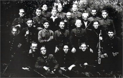"The unit of the Sec. Lt. ""Olech"". In the center, sitting are: Sec. Lt. ""Olech"", and Sgt. ""Irena"" who died on May 17, 1949 near Starodworce during combat with the NKVD. ""Olech"" who was shot in both legs, stayed behind and covered retreat of his unit. In the end, he shot himself, rather than allowing himself to fall into the Soviet hands."