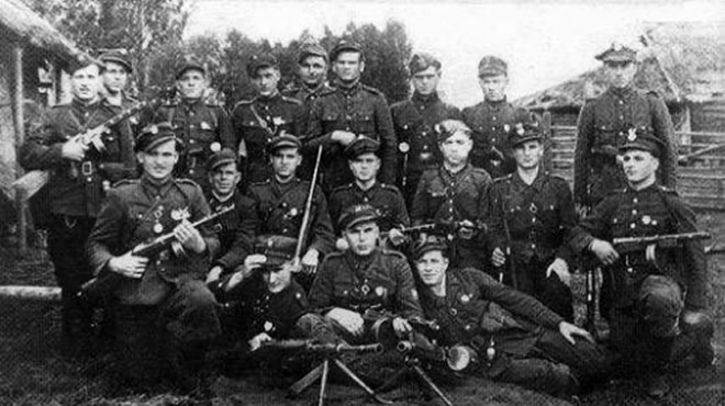 "The partisan unit of Bronisław Zabłocki, nom de guerre ""Oczko"" in the Puszcza Nalibocka, in October 1945. For the most part, this unit consisted of partisans from the III and VI Battalion of the Home Army's 77 Infantry Regiment. It conducted many self-defense operations against the NKVD. In November 1945, it was disbanded, and via PUR transports its men were secretly moved ""to Poland"". From among them, two groups made it through, but the third one fell into the NKVD hands and was never seen again."
