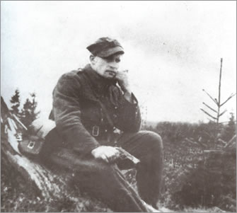"Józef Kuraś nom de guerre ""Orzeł"" [tr. ""Eagle""] was a pre-war graduate of the junior officers' school of the Border Security Corps [acr. KOP – Korpus Ochrony Pogranicza] and a participant of the September Campaign of 1939, serving in the 1st Podhale Rifle Regiment. In the Armed Struggle Association – Home Army conspiracy [Pol. Abbr. ZWZ-AK] from November 1939. In 1940, he joined the Tatra Confederacy and from autumn that year onwards operated in the resistance movement as a commander of one of the Tatra Confederacy combat units. On the June 29, 1943, the Germans shot his wife, their 2-1/2 year-old son Zbyszek and his 73-year-old father, after which they burnt the family home. As a result of these tragic events, the ""Eagle"" changed his nom de guerre to 'Fire' [pol. ""Ogień""] and used it until his death on Feb 21, 1947."