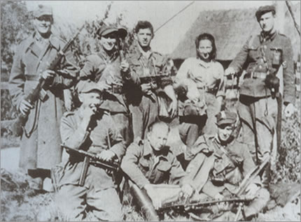 "The soldiers of the Home Army 5th Vilnius Brigade 4th Squadron. From the right: Cavalry Sgt Jerzy Lejkowski nom de guerre ""Szpagat"", Danuta Siedziakówna nom de guerre ""Inka"", Capt. Bohdan Obuchowski nom de guerre ""Zbyszek"", in the middle, sitting, Kazimierz Kwiatkowski. Among the weaponry, particular attention should be paid to a very good Soviet self-loading Tokarev rifle SVT-40, calibre 7.62 mm [held by the first soldier from the left]."