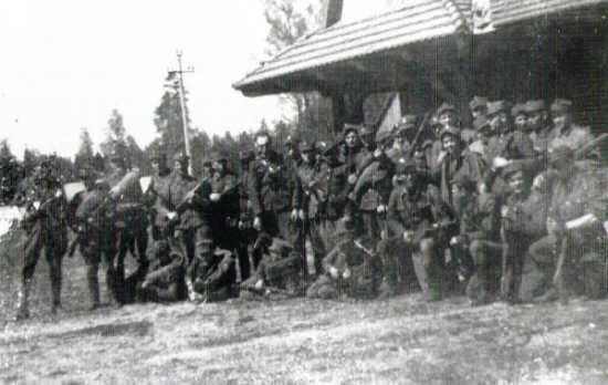 "The 1st Squadron during the stop-over in Białowieża Forest. 9th from the left Lieutenant ""Zygmunt"" (May 1945)"