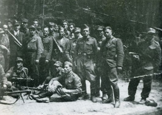 A group of soldiers from the 'Uskok' unit during mobilisation gathering in the forests of Kozlow (stary Tartak), July 1944. Standing in the first row: fourth from the left – Second Lieutenant Zdzislaw Bronski, nom de guerre 'Uskok', fifth from the left – Sergeant Kocyla, nom de guerre 'Jastrzab' [Eng.tr.Hawk], sixth from the left – Zygmunt Libera, nom de guerre 'Babinicz'; sitting: first from the right – Jan Mendel, nom de guerre 'Czarny' [Eng.tr.Black].