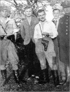 Summer of 1946. Soldiers from the division of Major 'Zapora', standing from left to right: - Zbigniew Sochacki ['Zbyszek'], first aide to 'Zapora'. On the 3 July 1946, he was injured in a fight with an operational group of the UB; he committed suicide by shooting himself; Sergeant Kazimierz Stefańczyk ['Sokół']; Major Hieronim Dekutowski ['Zapora']; Lt. Kazimierz Pawłowski ['Nerw'], arrested on 1 July 1948, sentenced to death, murdered on 10 February 1949; Lt. Szczepan Żelazny ['Żaba'], platoon commander in the unit of Major 'Zapora'.