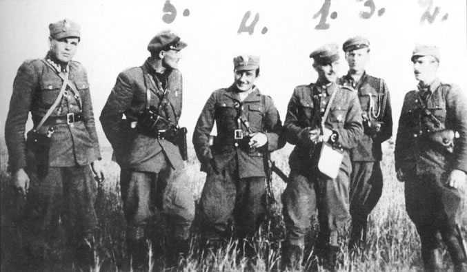 "Soldiers from the Maj. ""Zapora"" unit. Standing form left are: NN [Pol. acr. Nieznany I Niezidentifikowany – unknown and unidentified] soldier, Stanisław Łukasik, nom de guerre ""Ryś"", murdered on March 7, 1949 at the Mokotów prison; Aleksander Sochalski, nom de guerre ""Duch"", Hieronim Dekutowski, nom de guerre ""Zapora"", murdered on March 7, 1949 at the Mokotów prison in Warsaw; Zbigniew Sochacki, nom de guerre ""Zbyszek"", wounded during a firefight with UB on July 3, 1946, committed suicide; , Jerzy Korcz, nom de guerre ""Bohun"", KIA in January 1947."